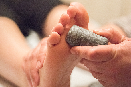 Reflexology services with hot stones